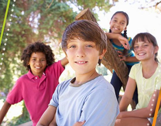 Four teens smiling at camera