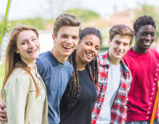 Group of five teens standing together smiling