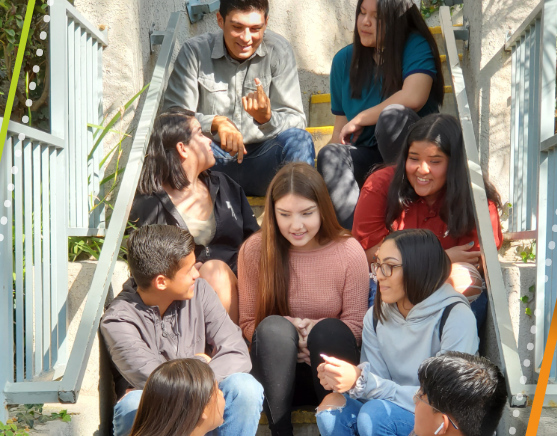 Group of teens sitting on a staircase talking