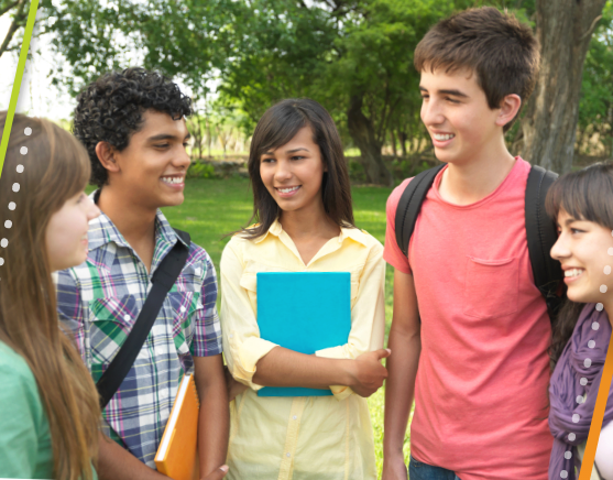 Group of teens talking in the park after school