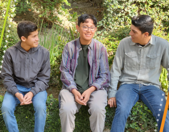 Group of teen boys sitting and talking